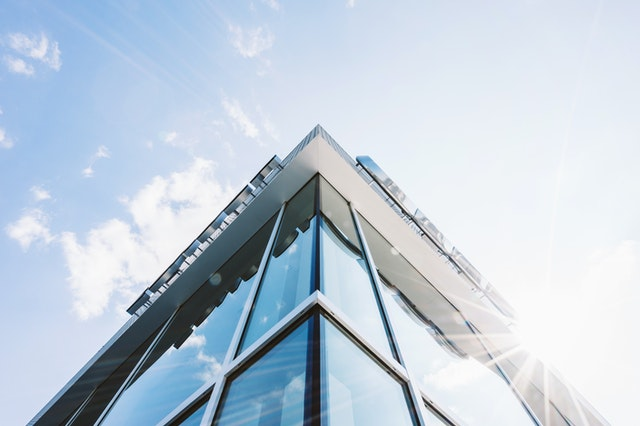 glass windows on a business office building on a sunny day